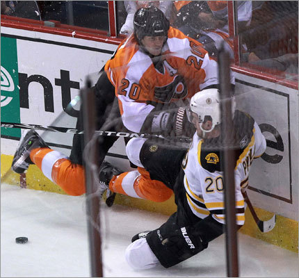 Bruins left wing Daniel Paille (right) and Flyers defenseman Chris Pronger were both penalized after colliding along the boards behind the Flyers' net. Paille received two minutes for tripping, Pronger two for slashing.