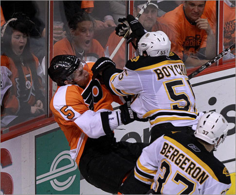 Bruins defenseman Johnny Boychuk played rough with Flyers defenseman Braydon Coburn behind the net in the second period, and drew gasps from Flyers fans in the front row.