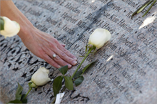 As people around the world reacted to Osama bin Laden's death, family members and supporters visited the Public Garden for a moment of silence to the victims of 9/11 on Monday. Read on to see scenes from the Public Garden. Read the article. In this photo, a person touched the name of a victim as white roses adorned the memorial.