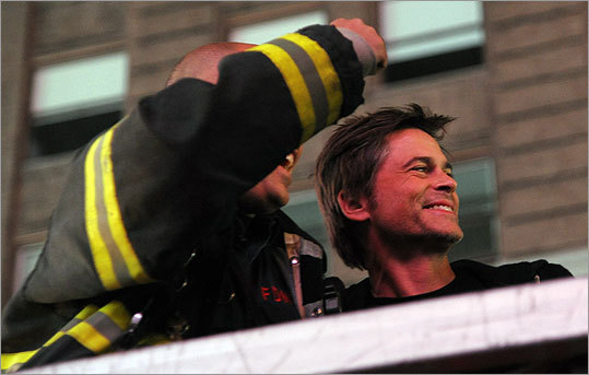 Actor Rob Lowe posed with a New York City fireman in Times Square shortly after the announcement.