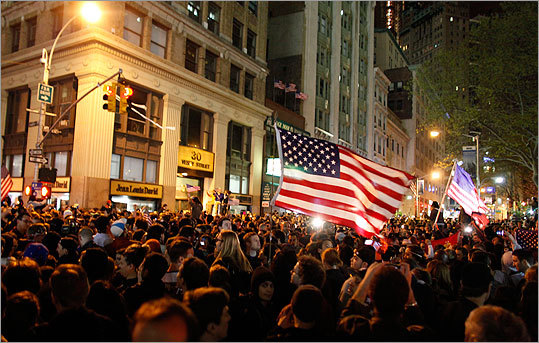 A large crowd gathered at the corner of Church and Vesey streets, adjacent to Ground Zero, in New York City.