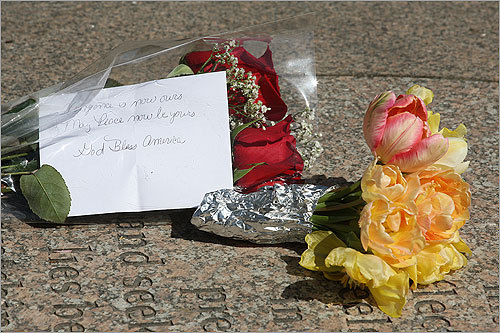 An emotional note to a loved one and and flowers were left at the memorial.