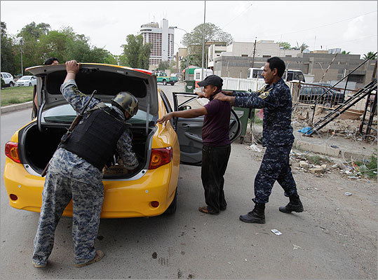Security increases also took place around the world, as Iraqi police officers monitored a central Baghdad checkpoint.