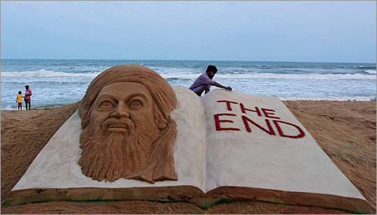 Indian sand artist Sudarshan Pattnaik gave finishing touches to a sand sculpture to mark the killing of Osama bin Laden at the golden sea beach at Puri, Orissa, India.