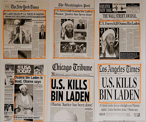 Newspaper headlines and clippings on the death of Osama bin Laden were posted on a wall inside a staff office at the White House.