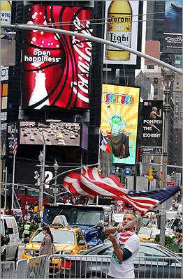 Colin Marshal, of Little Falls, N.J., waved an American flag in New York's Times Square.