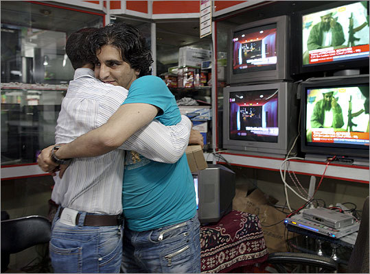 Afghan men working at a Kabul TV shop hugged each other while watching the news of Osama bin Laden's death.