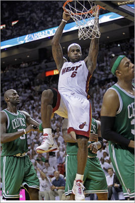 LeBron James and the Miami Heat slammed the Celtics 102-91 in Game 2 of their NBA playoff series in Miami Tuesday. The game was tied 80-80 with 7:10 to play, but the Heat went on a 14-0 run -- including James's dunk -- to put the game out of reach for the Celtics. The series shifts to Boston for Game 3 on Saturday, but the Heat lead 2-0.