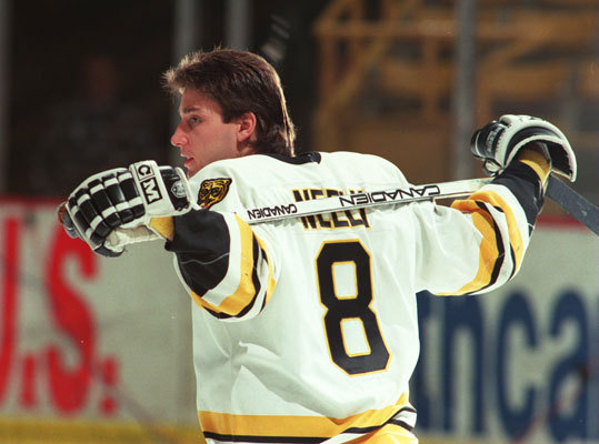 1989-90 Stanley Cup finalists Cam Neely (pictured) had the first of three 50-goal seasons in his career, netting a career-best 55 while also compiling 117 penalty minutes. Ray Bourque was his typically stellar self with 19 goals and 65 assists, and Bobby Carpenter (25), Craig Janney (24), and Bob Sweeney (22) all had more than 20 goals. In net, Andy Moog and Reggie Lemelin proved an outstanding tandem, and the Bruins won the Adams Division with 101 points. After a memorable Game 1 of the Finals in which the Oilers beat the Bruins in triple overtime, the Bruins fell to Edmonton again, this time in five games. It stands as the Bruins' last appearance in the finals.