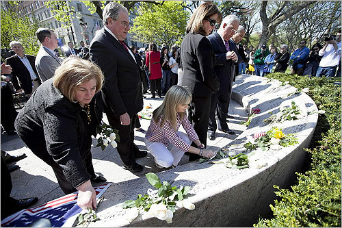 Boston Mayor Thomas Menino and Governor Deval Patrick, back, placed flowers at the memorial.