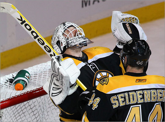 Bruins goalie Tim Thomas made 37 saves and picked up his seventh win of the playoffs. He celebrated after the final horn with defenseman Dennis Seidenberg.