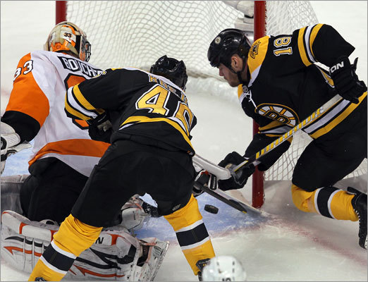 Both Krejci (left) and Horton couldn't get a stick on a loose puck that got behind Flyers goalie Brian Boucher in the first period.