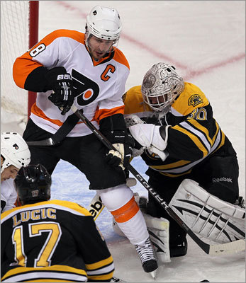 Thomas fought for space with Flyers captain Mike Richards in the first period.