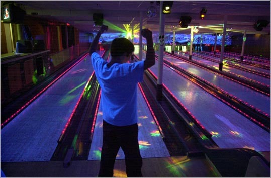 Needham Bowlaway, another local favorite, it shut its doors last month. Left: Cody Sharib celebrates a good roll during a game of cosmic bowling in 2001 at Bowlaway.