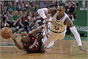 Rajon Rondo dives for the ball