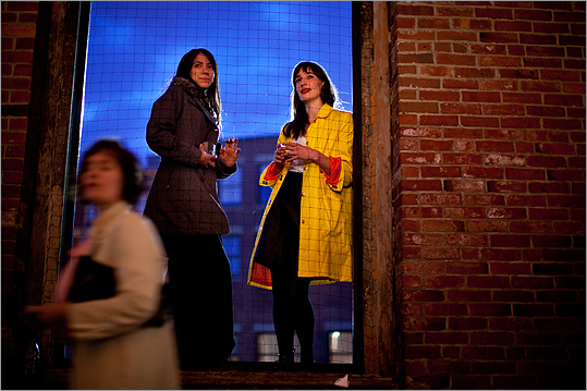 From left, Elizabeth Ginoza and Aimee Groen watched the festivities from outside the Power Station.