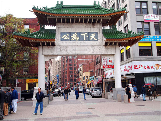 Take some time and roam the streets of Chinatown, one of Boston's most vibrant neighborhoods. Left: The instantly recognizable paifang gate, one of many in Chinatown neighborhoods across the US, was a gift to Boston's Chinatown from the government of Taiwan.