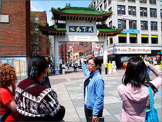 Amy Cheung (center) was born in the US to immigrants from China and said her mother felt moved when she moved to Boston and first saw Chinatown's paifang gate. 'As a new immigrant, oftentimes she felt sort of isolated and lonely, didn't have that kind of family connection that she had when she was in China, and when she did see this gate, she felt like, Oh, there's home,' Cheung said.