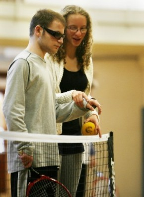 """It really has given me confidence and it proves that people with disabilities can do whatever they set out to do,' Bernard said. 'If I wake up tomorrow and someone says, 'Let's play tennis,' I'll figure out a way to do it.'' Rachel Kronberg (right) from Newton North and Jeffery Gianni."