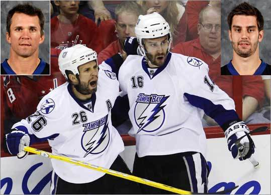 Teddy Purcell, Tampa Bay Lightning Bad pun alert: Purcell (right) looks more like a grizzly bear than a Teddy, no? The 25-year-old has 11 points in 11 playoff games. At left is teammate Martin St. Louis.