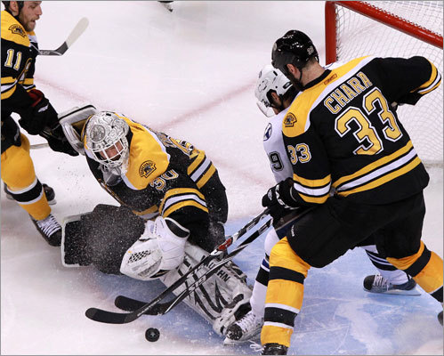 Bruins defenseman Zdeno Chara provided goalie Tim Thomas with some help by checking Lightning center Dominic Moore in the crease during the second period.
