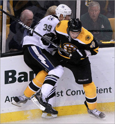 Bruins center Tyler Seguin puts a hit on Lightning defenseman Mike Lundin in the second period.