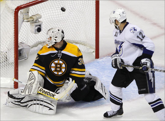 The Tampa Bay Lightning took Game 1 of their NHL Eastern Conference finals series 5-2 over the Bruins at TD Garden. Marc-Andre Bergeron (not pictured) gave the Lightning a 4-1 lead when he zipped one past bruins goalie Tim Thomas in the third period. Simon Gagne is at right.