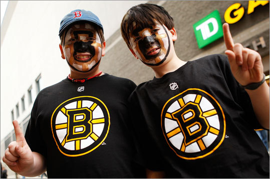 A pair of fans showed their allegiance with face paint and team shirts.