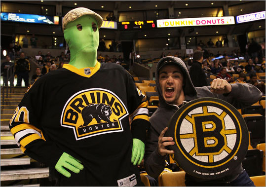 One fan took a page from the Vancouver fan playbook and dressed as a Green Man, customized for TD Garden. His pal took a more traditional approach.