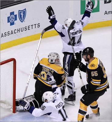 Brett Clarke (not pictured) scored just 19 seconds after Sean Bergenheim's goal to give the Lightning a 2-0 lead, and Nate Thompson and Teddy Purcell celebrated in front of goalie Tim Thomas.