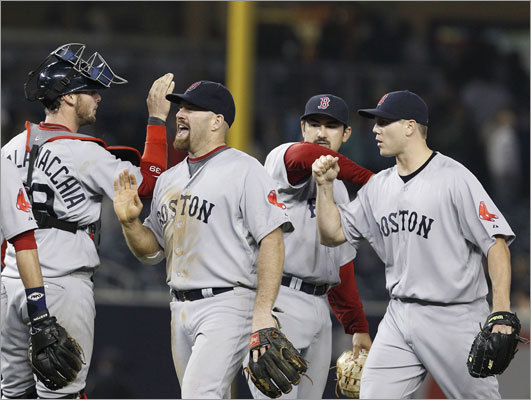 Catcher Jarrod Saltalamacchia, third baseman Kevin Youkilis, first baseman Adrian Gonzalez and closer Jonathan Papelbon (from left) had plenty to cheer after the Red Sox defeated the Yankees 7-5 to complete a sweep of their three-game series at Yankee Stadium this weekend.