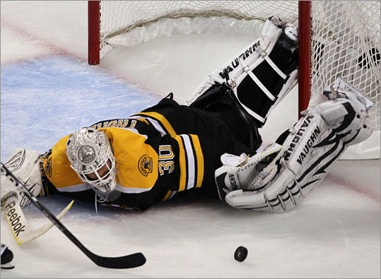 Bruins goalie Tim Thomas went to great lengths to keep the Lightning out of the net.