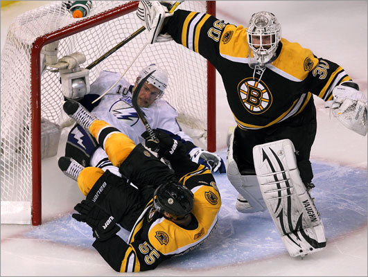 Boston's Johnny Boychuk and Tampa Bay's Sean Bergenheim ended up in the net in the third period, but goalie Tim Thomas made sure the puck did not.