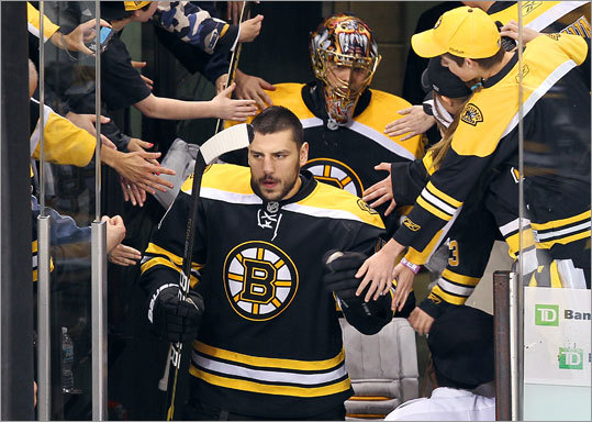 Bruins left wing Milan Lucic was greeted by fans as he entered the ice for pregame warmups.