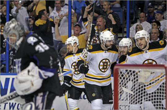 Bruins center David Krejci (second from right) scored in the first period, which made a few Bruins fans who were at the St. Pete Times Forum happy.