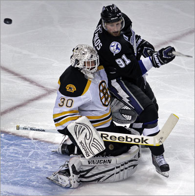 Bruins goalie Tim Thomas gave no ground when Tampa Bay's Steven Stamkos slammed into him in the third period at the St. Pete Times Forum in Tampa, Fla.