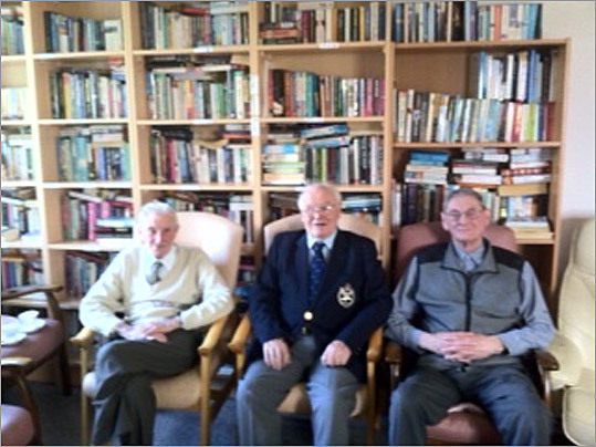 From left, Jim Redmond, Johnny Wetherall, John Crisp, who served in the British forces during World War II, watched Queen Elizabeth II's visit to Ireland at Leopardstown Park Hospital, a home for British forces veterans in Ireland.