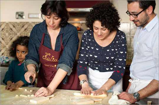 With her daughter, Sofia, cooking school instructor Katia Amore (second from left) and her students form fresh pasta dough into bite-sized pieces before turning it into cavatelli. Read: Three courses, one cuisine