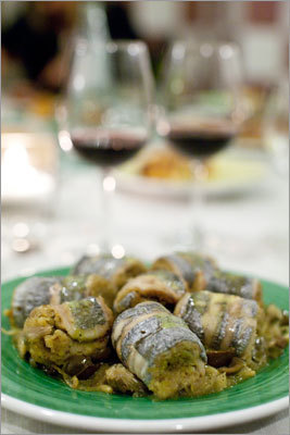 Scabbard fish filets wrapped around a mixture of almond, flour and breadcrumbs, served atop olives, capers, and slow-cooked onions at his Modica restaurant, La Gazza Ladra. Read: Three courses, one cuisine