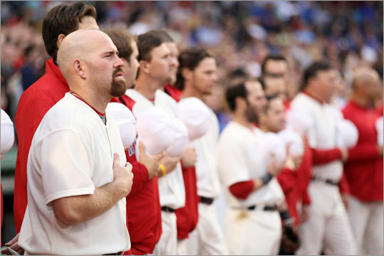 Kevin Youkilis and the Red Sox listened as the national anthem was played on an organ prior to throwback night at Fenway Park. Many old-time touches were added to the game presentation, including a silent inning and announcements via megaphone.