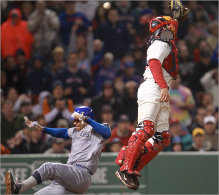 Cubs first baseman Carlos Pena (22) scored during the eighth inning after shortstop Jed Lowrie dropped a pop-up and the throw to catcher Jason Varitek was high.