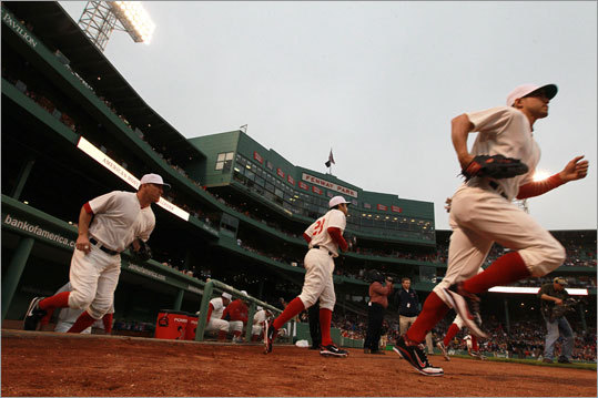 Jacoby Ellsbury (right) and J.D. Drew (left) trotted out to their positions wearing 1918 throwback uniforms for Game 2 of the Cubs-Red Sox series at Fenway Park. Both teams wore replicas of the togs they sported the last time they met at Fenway Park, which was the 1918 World Series. The Red Sox lost to the Cubs, 9-3, in the second game of their weekend series.
