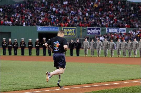 Before the final game of the Red Sox' interleague series vs. the Cubs at Fenway Park, Marine Sgt. Terrence Burke of Dorchester ran the bases as part of the Red Sox' Run to Home Base event. He was injured while serving in Iraq. Earlier in the day, more than 2,000 runners participated in a nine-kilometer race that featured home plate in Fenway as the finish line. The event raised money for the Red Sox Foundation and the Massachusetts General Hospital Home Base Program.