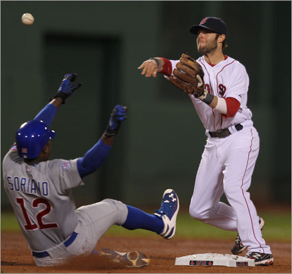 Red Sox second baseman Dustin Pedroia turned a double play as Cubs designated hitter Alfonso Soriano slid into second base in the third inning.