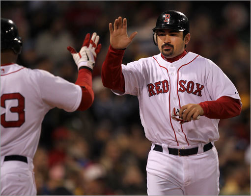 Adrian Gonzalez was congratulated by Carl Crawford after scoring the Red Sox' first run in fourth inning. Gonzalez scored from third on a sacrifice fly by Jed Lowrie.