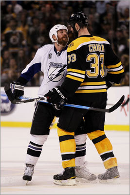 Tampa Bay's Ryan Malone had a brief chat with Boston's Zdeno Chara during a break in the action.