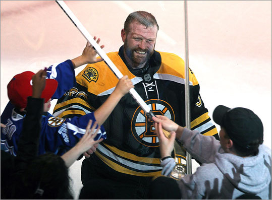 After Tim Thomas was named the No. 1 star of the game, he gave his stick to a young fan wearing a No. 30 jersey (in blue, at left). Thomas also wears No. 30.