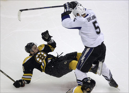 The intensity was at compete level 11 from the get-go in Game 5 of the Bruins-Lightning Eastern Conference finals at TD Garden. Bruins center Brad Marchand (left) was leveled by Lightning defenseman Mattias Ohlund early in the first period.