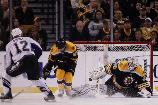 Simon Gagne put the Lightning up 1-0 in the first period when he chipped one through Johnny Boychuk's legs and past goalie Tim Thomas.