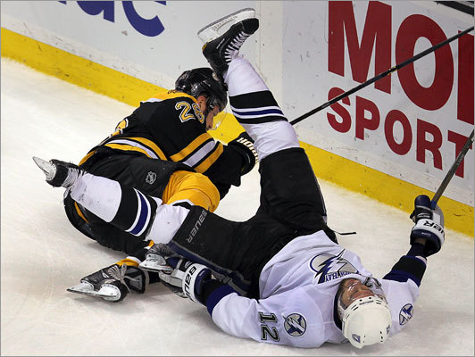 Bruins right wing Mark Recchi and Lightning left wing Simon Gagne both went downafter colliding behind the Tampa Bay net in the first period.